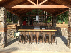 Outdoor cooking bar front; T & G barn  wood used as paneling