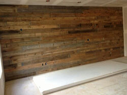 Raw barn wood ( no T & G ); Used as an accent wall in a bedroom