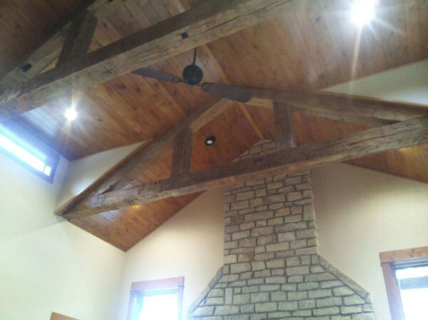8 x 8 hand hewn beams create truss for great room ceiling