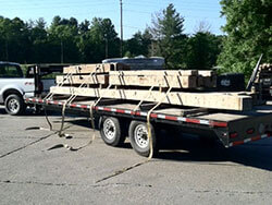 Hand hewn beams heading to the job site