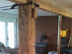 10 x 10 hand hewn beams cut in half to cover up steel poles