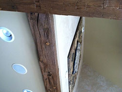 8 x 8 hand hewn beams cut into 4 x 8 and attached to smooth ceiling