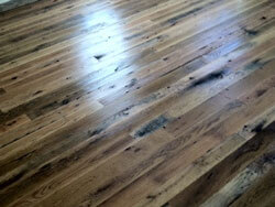 Barn wood Floor, matching baseboards; 3-4-5 inch faces, dark stain applied