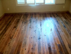 Reclaimed Mixed oak, Barn wood floor; 3-4-5 inch faces, lightly stained