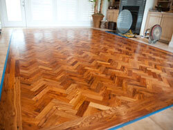 Wormy Chestnut Floor; Marble Boarder, Gulf Shores Ala; Herringbone pattern