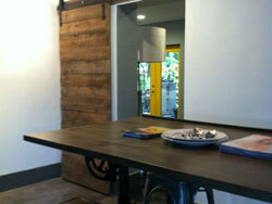 2 inch thick barn boards create sliding door, Miami Fla