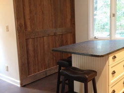 Large dirty top pine boards enhance sliding barn  door