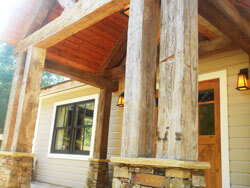 Hand hewn beams create entry for Bed and Breakfast